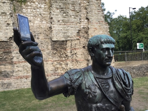 Augustus with a mobile phone